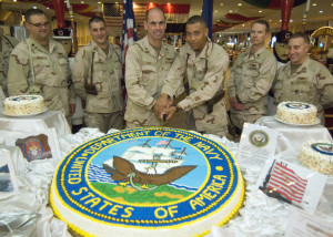 081013-N-4281P-020 BAGHDAD (Oct. 13, 2008) The senior and junior Sailors present, Rear Adm. David Buss, director of Multi-National Forces-Iraq Strategy, Plans and Assessments, and Yeoman 3rd Class Jonathan Edwards, MNF-I Strategic Communications, cut the celebratory cake during the NavyÕs 233rd birthday celebration at the U.S. Embassy in Baghdad. (U.S. Navy photo by Mass Communication Specialist 2nd Class Woody Paschall/Released)